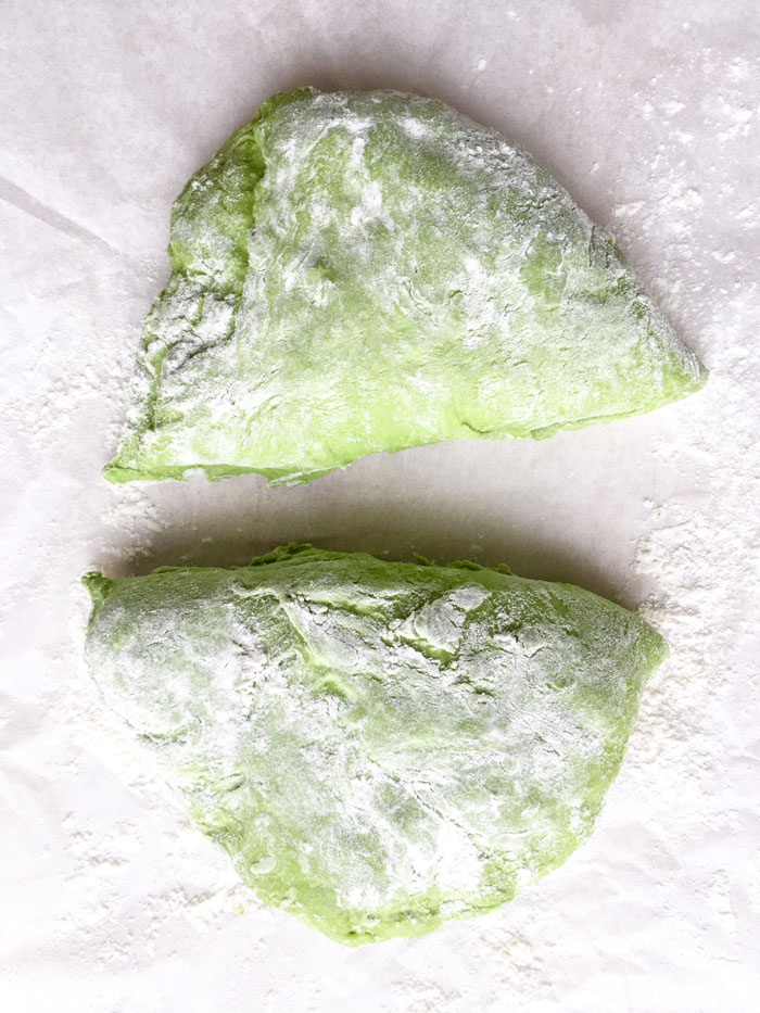 vegan homemade spinach dough cut in half